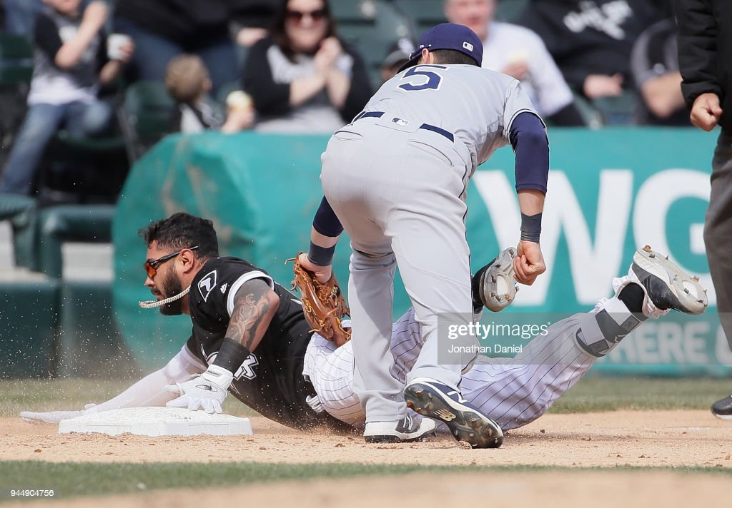 Omar Narvaez #38 of the Chicago White Sox is safe at third base under the tag attempt by Matt Duffy #5 of the Tampa Bay Rays after advancing on two errors by the Rays in the 7th inning at Guaranteed Rate Field on April 11, 2018 in Chicago, Illinois. The White Sox defeated the Rays 2-1.