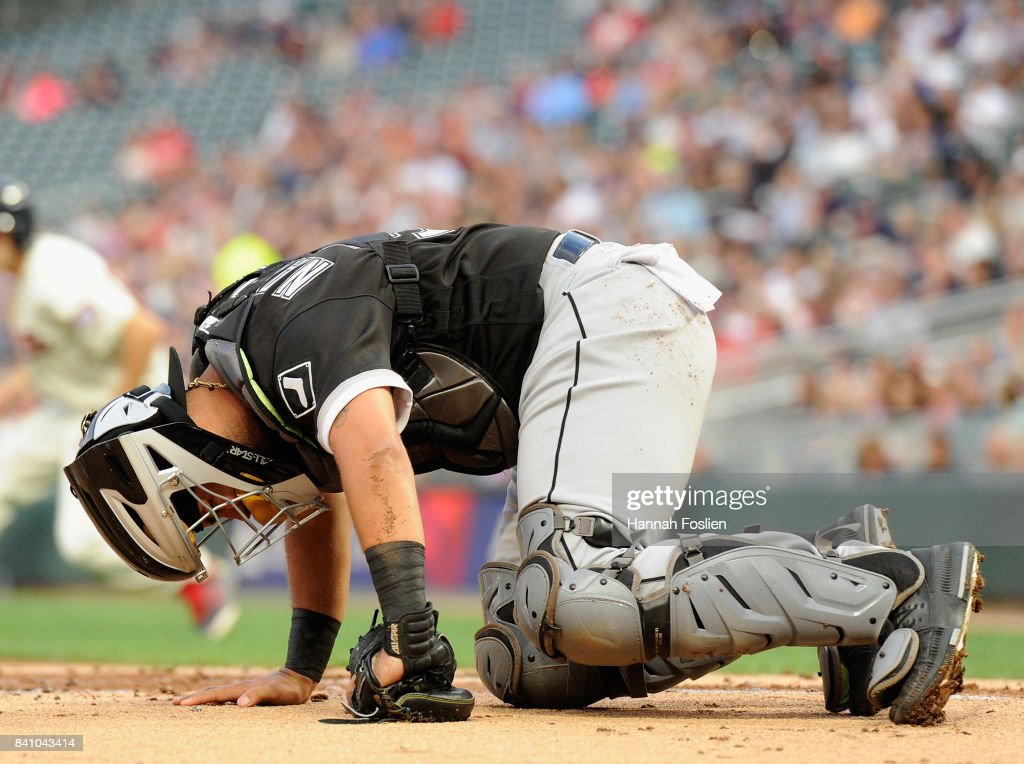Omar Narvaez #38 of the Chicago White Sox reacts after being hit by a pitch while catching during the first inning of the game against the Minnesota Twins on August 30, 2017 at Target Field in Minneapolis, Minnesota.