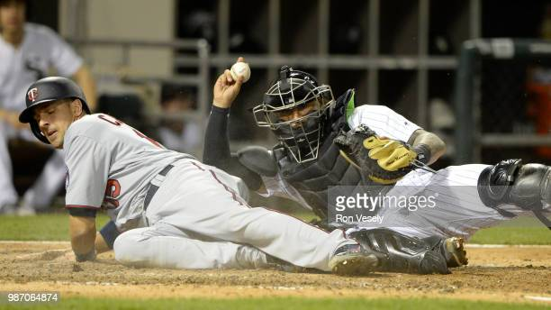 Omar Narvaez of the Chicago White Sox tags out Jason Castro of the Minnesota Twins on May 4, 2018 at Guaranteed Rate Field in Chicago, Illinois.