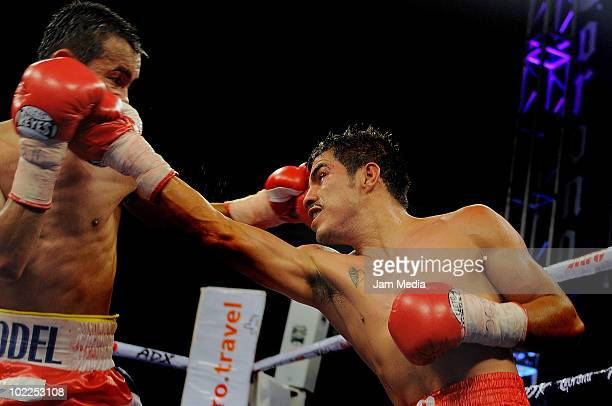 Omar Nino of Mexico fights against Rodel Mayol of Philippines in mini flyweight category at El Recinto Bullring on June 19 2010 in San Juan del Rio...