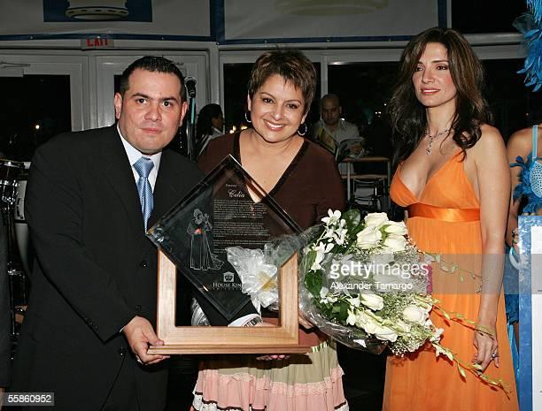 Omar Pardillo Maria Antonietta Collins Ileana Garcia pose at Bongos Cuban Cafe for the House King magazine premier party on October 5 2005 in Miami...