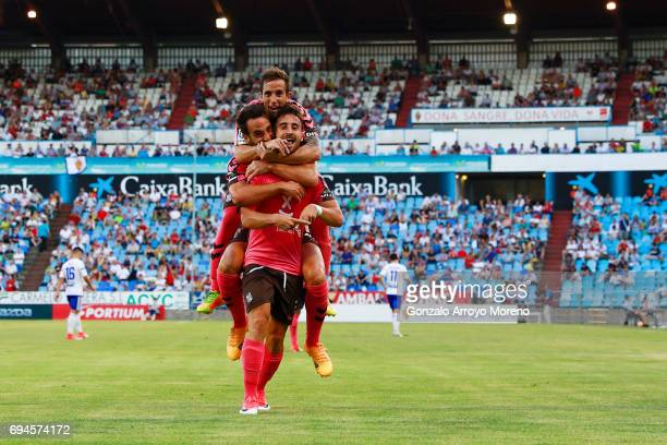 Omar Perdomo of CD Tenerife celebrates scoring their opening goal with teammates during the La Liga 2 match between Real Zaragoza and CD Tenerife at...