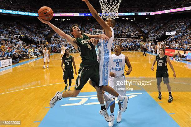 Omar Prewitt of the William Mary Tribe goes to the basket against Brice Johnson of the North Carolina Tar Heels during their game at the Dean Smith...