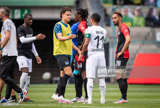 Omar Rekik of Hertha BSC and Raffael of Borussia Moenchengladbach after the Bundesliga match between Borussia Moenchengladbach and Hertha BSC at...