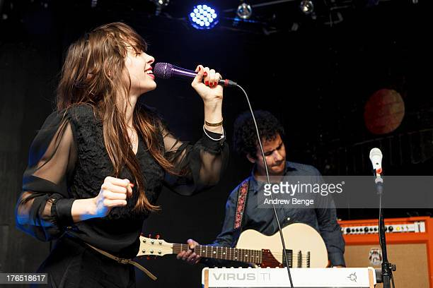 Omar Rodriguez Lopez and Teri Gender Bender of Bosnian Rainbows perform on stage at Brudenell Social Club on August 14 2013 in Leeds England