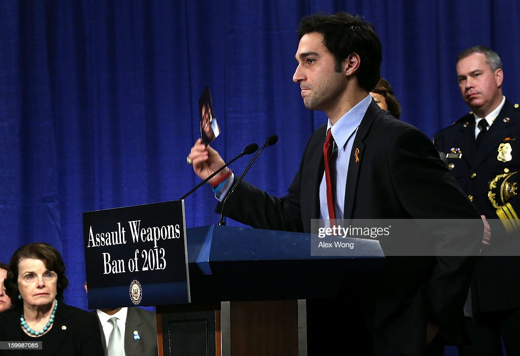 Omar Samaha (2nd R) holds up a photo of his sister Reema, who was shot and killed at the Virginia Tech shooting, as U.S. Senator Dianne Feinstein (D-CA) (L) looks on during a news conference on assault weapons ban January 24, 2013 on Capitol Hill in Washington, DC. Feinstein announced that she will introduce a bill to ban assault weapons and high-capacity magazines capable of holding more than 10 rounds to help to stop gun violence.