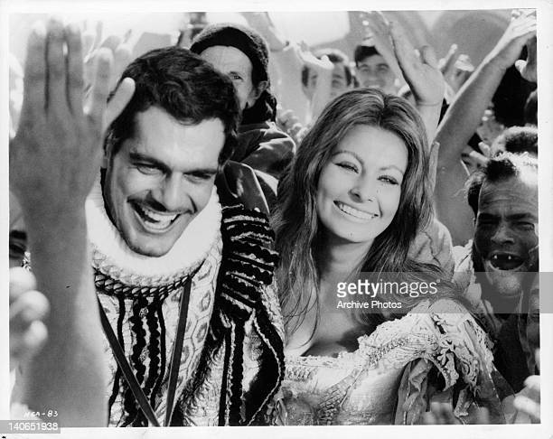 Omar Sharif as the prince claims Sophia Loren the peasant girl as his wife in a scene from the film 'More Than a Miracle' 1967