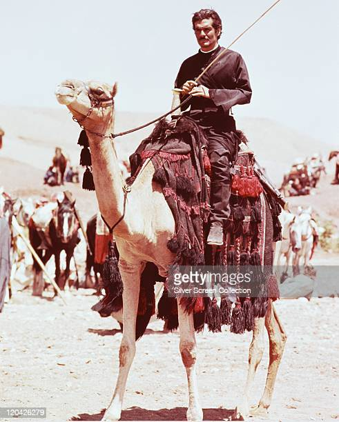 Omar Sharif, Egyptian actor, riding a camel in a publicity still issued for the film, 'Lawrence of Arabia', 1962. The historical drama, directed by...