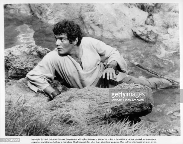 Omar Sharif escaping while in broken shackles in a scene from the film 'Genghis Khan' 1965