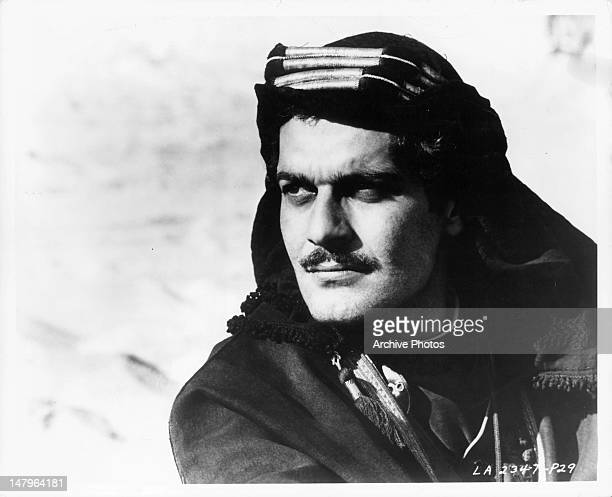 Omar Sharif looking over the desert in a scene from the film 'Lawrence Of Arabia', 1962.