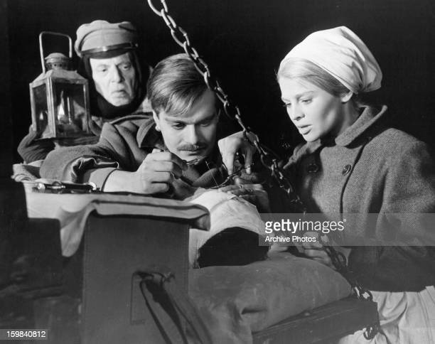 Omar Sharif performs surgery while Julie Christie assists him in a scene from the film 'Doctor Zhivago' 1965