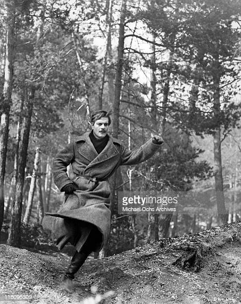 Omar Sharif races through the woods to reach the train carrying his family in a scene from the film 'Doctor Zhivago' 1965