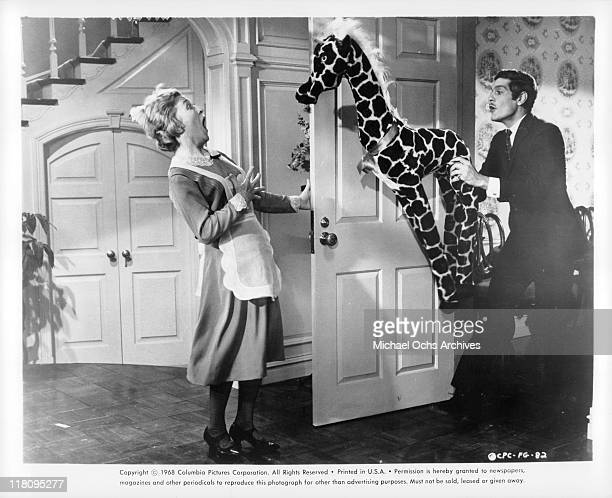 Omar Sharif scares maid with stuffed animal in a scene from the film 'Funny Girl', 1968.