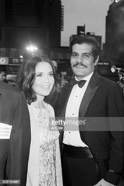 Omar Sharif with anjanette Comer posing for photos before a formal event circa 1970 New York