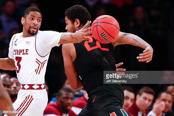 Omar Sherman of the Miami Hurricanes saves the ball behind Jesse Morgan of the Temple Owls during the NIT Championship semifinals at Madison Square...