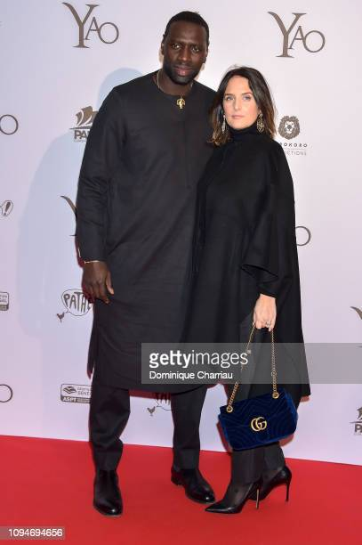 Omar Sy and Helene Sy attend the YAO Paris Premiere at Le Grand Rex on January 15 2019 in Paris France