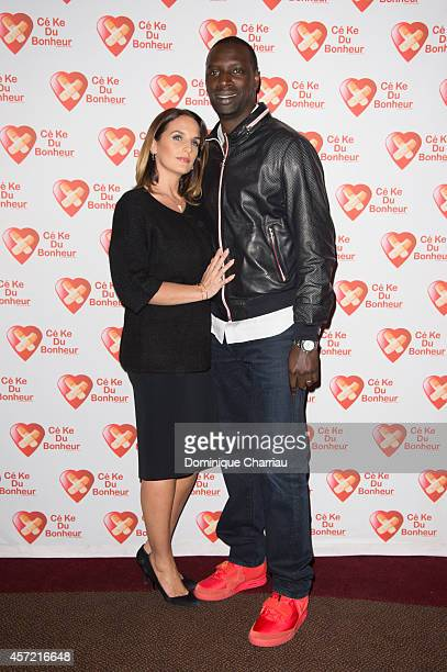 Omar Sy and his wife Helene attend the Samba Premiere To Benefit 'CekeDuBonheur' At Cinema Gaumont Champs Elysees on October 14 2014 in Paris France