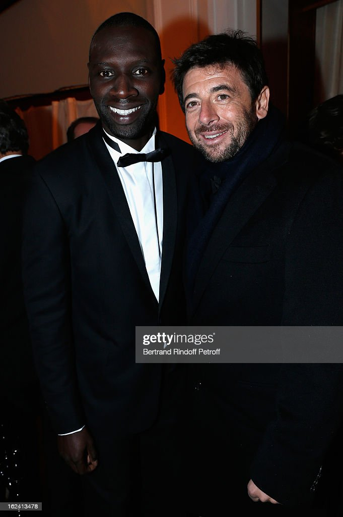 Omar Sy and Patrick Bruel attend the Cesar Film Awards 2013 at Le Fouquet's on February 22, 2013 in Paris, France.