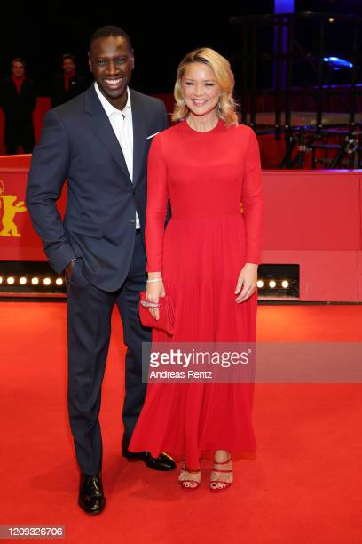 """Omar Sy and Virginie Efira arrive for the """"Police"""" premiere during the 70th Berlinale International Film Festival Berlin at Berlinale Palace on..."""