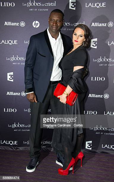 Omar Sy and wife Helene attend at the Globes de Cristal 2012 at the Lido in Paris