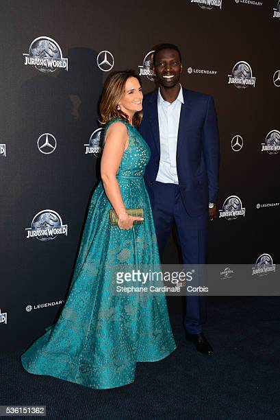 Omar Sy and wife Helene Sy attend the 'Jurassic World' Premiere at Cinema UGC Normandie on May 29 2015 in Paris France