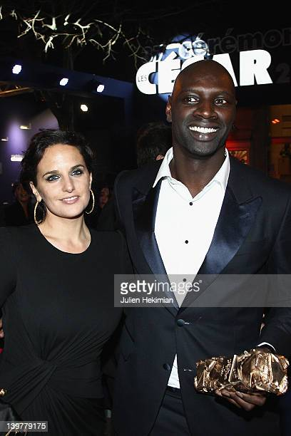 Omar Sy is pictured with his wife Helene Sy after being awarded at the 37th Cesar Film Awards at Theatre du Chatelet on February 24, 2012 in Paris,...