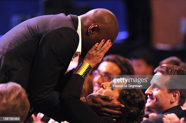 """Omar Sy reacts with his with Helene Sy after being awarded with the Best Actor Cesar for """"Intouchables"""" during the 37th Cesar Film Awards at Theatre..."""
