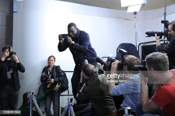 """Omar Sy takes a photo during the """"Police"""" photo call during the 70th Berlinale International Film Festival Berlin at Grand Hyatt Hotel on February..."""