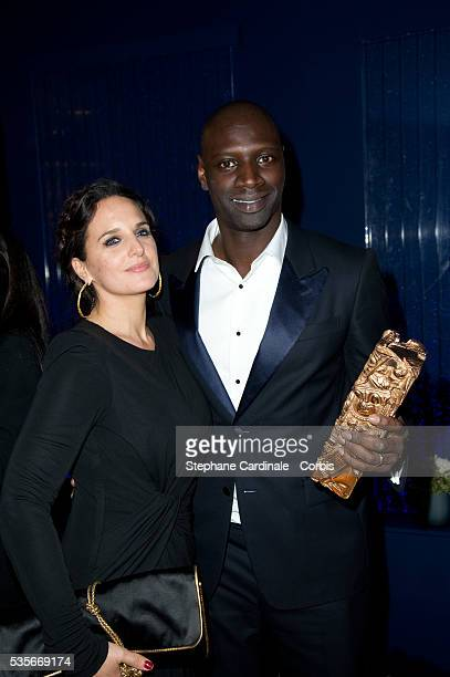 Omar Sy with his wife Helene pose as they arrived at the official Cesar Award dinner during the 37th Cesar Film Awards at Le Fouquet's, in Paris.