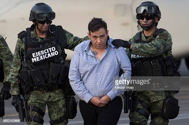"Omar Trevino alias ""El Z-42"" leader of criminal organisation ""Los Zetas"" is presented by Federal Police after his arrest in the Mexican State of..."