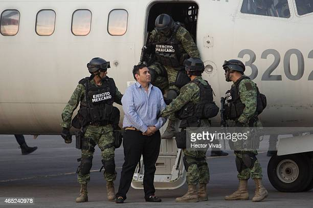 "Omar Trevino alias ""El Z-42"" leader of criminal organisation ""Los Zetas"" is escorted by Mexican Army after his arrest in the Mexican State of Nuevo..."