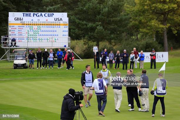Omar Uresti of the United States PGA Cup team shakes hand with David Higgins of the GBI PGA Cup Team during the Afternoon Foursomes on Day One of the...