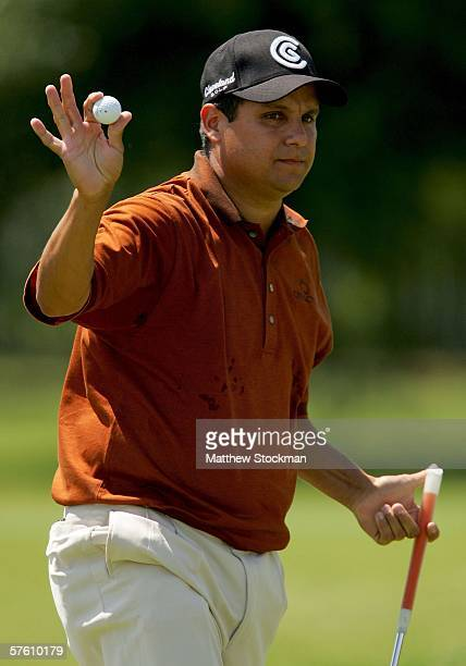 Omar Uresti waves to the gallery after a birdie putt on the 12th hole during the final round of the EDS Byron Nelson Championship on the TPC course...