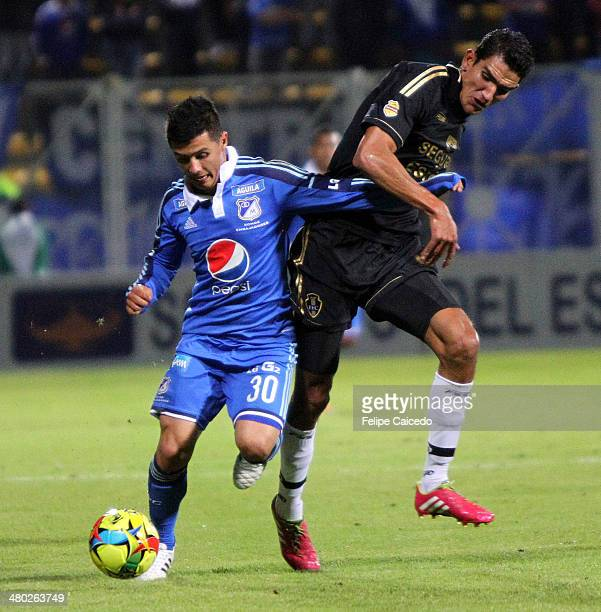 Omar Vasquez of Millonarios struggles for the ball with Diego Gomez of Fortaleza FC during a match between Millonarios and Fortaleza as part of the...
