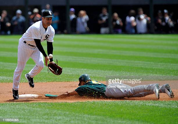 Omar Vizquel of the Chicago White Sox takes a throw as Coco Crisp Oakland Athletics steals a base on June 12 2011 at US Cellular Field in Chicago...