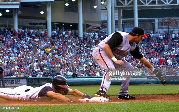 Omar Vizquel of the Cleveland Indians makes a head first slide into first base against the Cincinnati Reds at Jacobs Field Saturday June 12 2004 in...