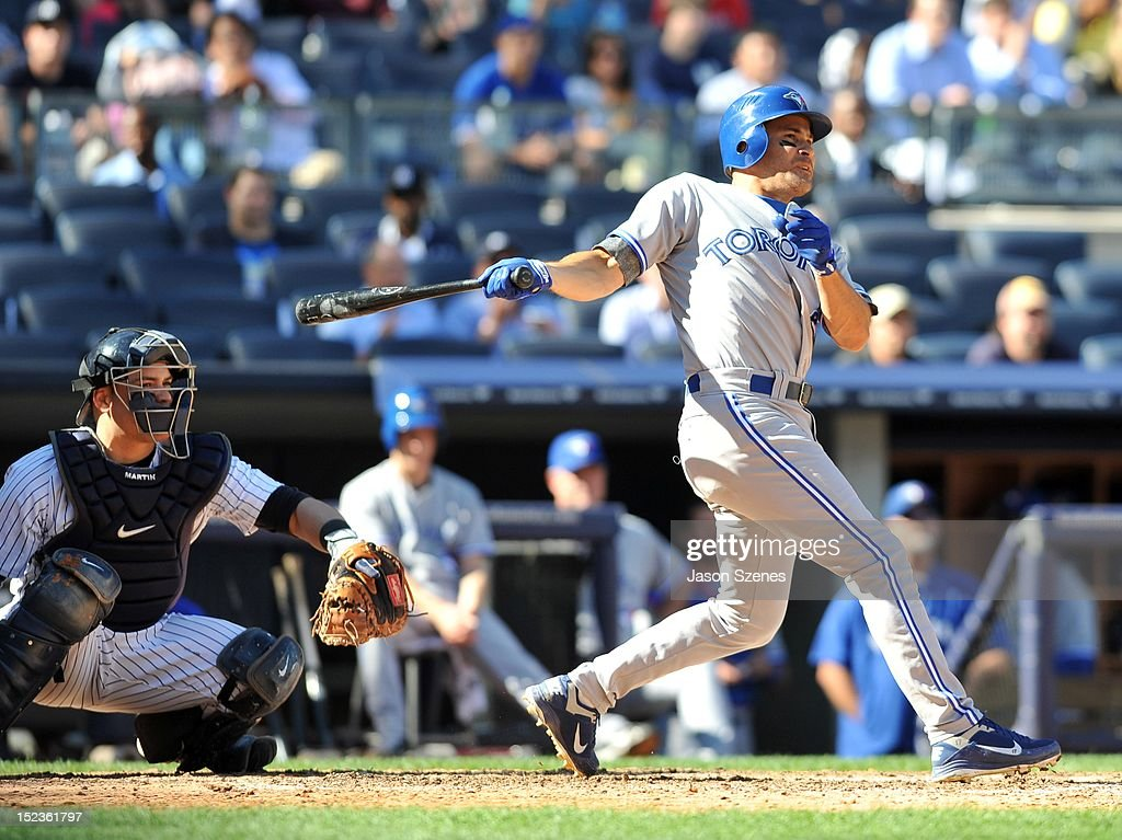 Omar Vizquel #17 of the Toronto Blue Jays connects on an RBI double in the eighth innng against the New York Yankees during the first game of a double header at Yankee Stadium on September 19, 2012 in the Bronx borough of New York City.