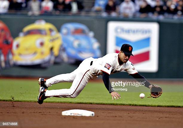 Omar Vizquel shorstop for the San Francisco Giants dives to stop a groundball by Andruw Jones of the Atlanta Braves during a game at ATT Park in San...