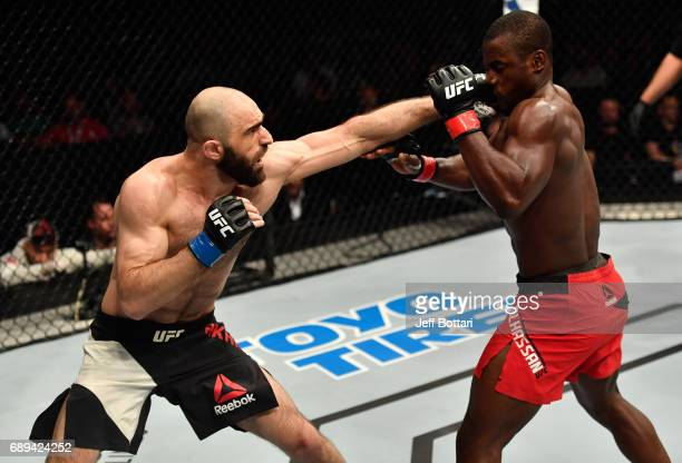 Omari Akhmedov punches Abdul Razak Alhassan in their welterweight fight during the UFC Fight Night event at the Ericsson Globe Arena on May 28 2017...