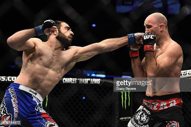 Omari Akhmedov punches Brian Ebersole in their welterweight bout during the UFC Fight Night event at Smoothie King Center on June 6, 2015 in New...