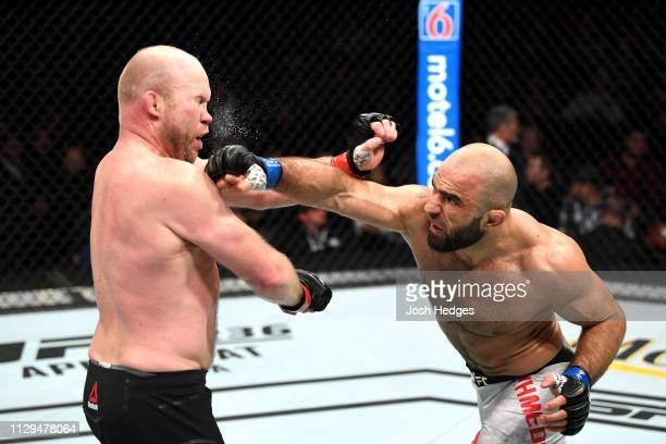 Omari Akmedov of Russia punches Tim Boetsch in their middleweight bout during the UFC Fight Night event at Intrust Bank Arena on March 9 2019 in...