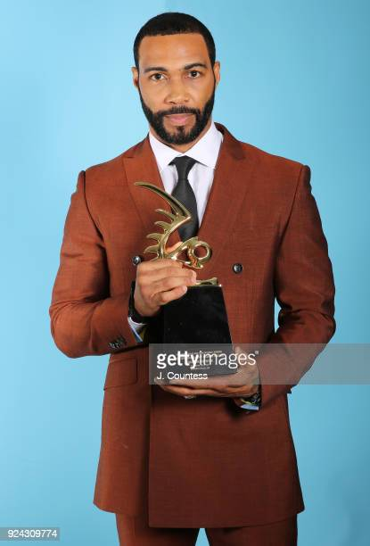 Omari Hardwick poses backstage with his award during the 2018 American Black Film Festival Honors Awards at The Beverly Hilton Hotel on February 25...