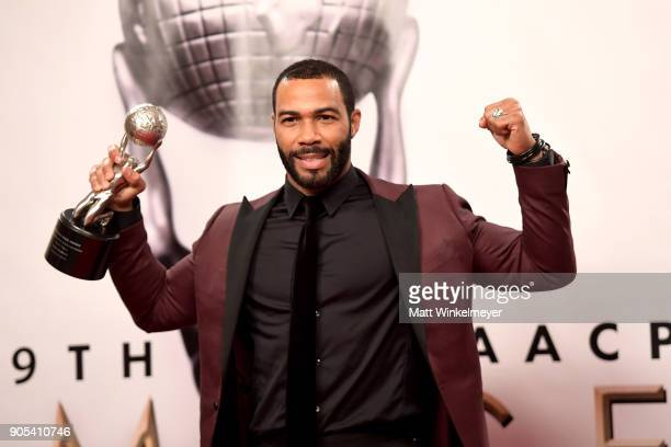 Omari Hardwick winner of the Outstanding Actor in a Drama Series award for 'Power' poses in the press room for the 49th NAACP Image Awards at...