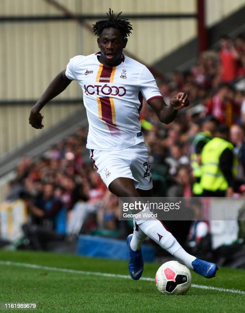 Omari Patrick of Bradford City runs with the ball during the PreSeason Friendly match between Bradford City and Liverpool at Northern Commercials...
