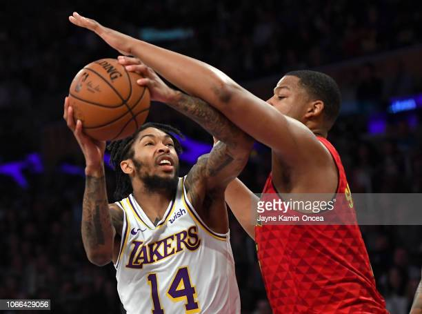 Omari Spellman of the Atlanta Hawks defends Brandon Ingram of the Los Angeles Lakers as he drives to the basket in the fourth quarter of the game at...
