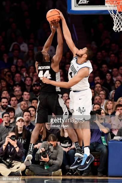 Omari Spellman of the Villanova Wildcats blocks the shot from Isaiah Jackson of the Providence Friars during the championship game of the Big East...