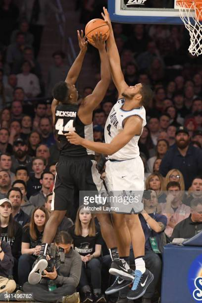 Omari Spellman of the Villanova Wildcats blocks the shot of Isaiah Jackson of the Providence Friars during the finals of the 2018 Big East Mens...