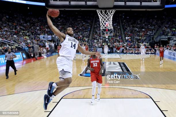 Omari Spellman of the Villanova Wildcats dunks the ball against the Radford Highlanders in the game in the first round of the 2018 NCAA Men's...