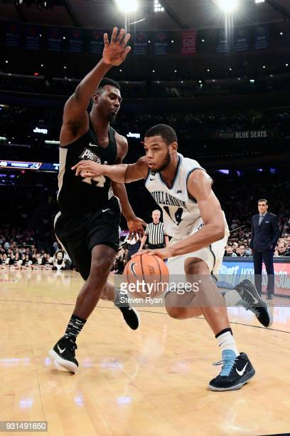 Omari Spellman of the Villanova Wildcats is defended by Isaiah Jackson of the Providence Friars during the championship game of the Big East...
