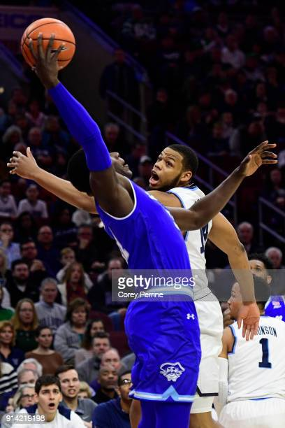 Omari Spellman of the Villanova Wildcats takes a swipe at the ball against Angel Delgado of the Seton Hall Pirates during the first half at the Wells...